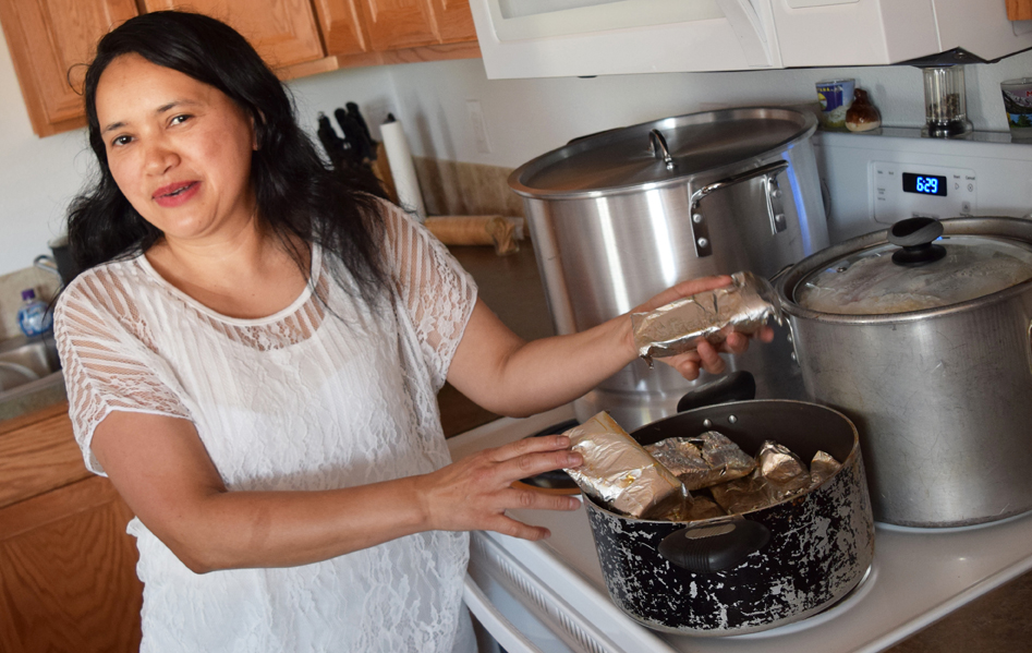 Photo of Orbelina Santos cooking in new kitchen