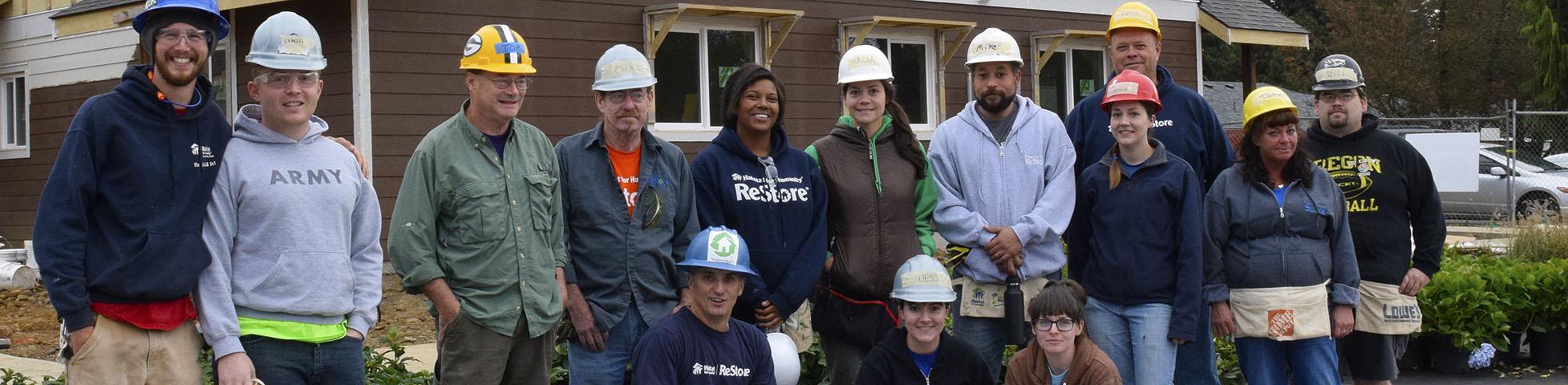 image of ReStore staff volunteering at Glisan Garden build site